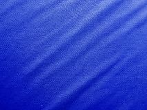 Sports clothing fabric jersey texture. Blue sports clothing fabric jersey texture Royalty Free Stock Images