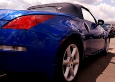 Blue Sportscar From the Rear. A blue convertible sportcar from the rear on a cloudy day Royalty Free Stock Photography