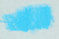 Blue spot on white textured paper. abstract background Royalty Free Stock Images