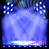 Blue spotlight background Stock Images