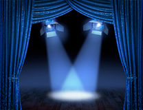 Blue spotlight beams premiere Stock Photography
