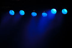 Blue spotlights. Spotlights and smoke. The spotlights is taken from a stage stock photography