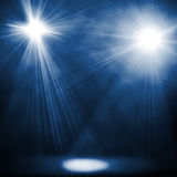Blue spotlights Stock Images