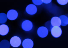 Blue spots on a black background. Abstract background. Blue spots on black background Stock Photography