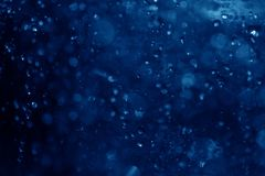 Blue spray fountain at night. In the club Stock Photo