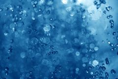 Blue spray fountain at night. In the club Royalty Free Stock Photo
