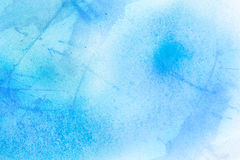 Blue spray on paper Stock Photo