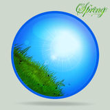 Blue spring glass sphere with grass and sunny sky Stock Photos