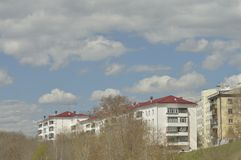 Blue spring sky over the city royalty free stock images