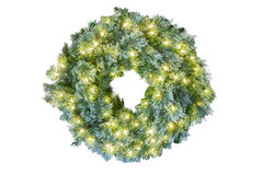 Blue spruce Christmas holiday wreath glowing with white lights Stock Photo