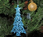 Blue spruce. christmas toys on new year tree background. Stock Photo