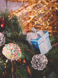 Blue spruce tree branches with Christmas baubles Stock Photos
