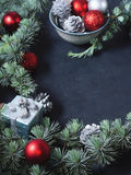 Blue spruce tree branches with Christmas baubles. Copy space Stock Photography