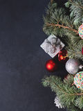 Blue spruce tree branches with Christmas baubles Royalty Free Stock Photography