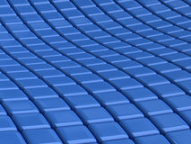 Blue square background. Abstract background with rows of undulating 3d beveled blue squares Royalty Free Stock Photos