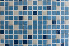Blue square ceramic tiles in the pool or bathroom pattern texture background royalty free stock photography