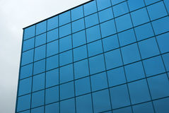 Blue square glass building facade. Glass building blue square patern Royalty Free Stock Photos