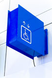 Blue square handicap sign with wheelchair elevator  on w. Hite background. (Selective Focus Stock Image