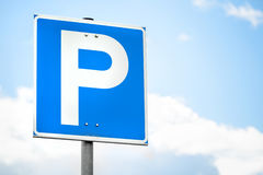 Blue square parking road sign over bright sky Stock Image
