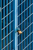 Blue square shaped grates locked with a padlock Stock Photo