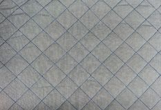 Blue square stitched on silver grey quilt seamless background pa. Ttern and texture Royalty Free Stock Images