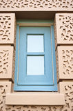 Blue square window in brown wall at Grand Palace Royalty Free Stock Photo