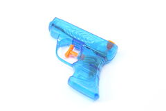 Blue Squirt Gun. Blue plastic toy squirt gun photographed on a white background stock photo