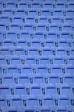 Blue Stadium Chairs - Repeating Texture. Repeating pattern texture of blue stadium chairs Royalty Free Stock Photography