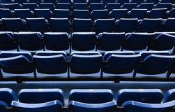 Blue stadium chairs in Thailand Stock Images