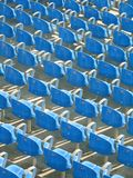 Blue stadium seats. Empty rows of blue stadium seats, seen from behind and above Stock Photos