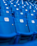Blue Stadium Seats. A Section of blue stadium seats with some visible seat numbers royalty free stock photo