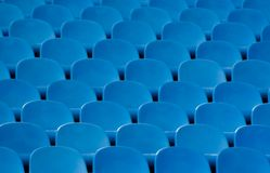 Blue stadium seats. Abstract view of partial rows of blue stadium seats royalty free stock photo
