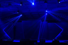 Blue stage light. Blue stage and bright beautiful rays of light Royalty Free Stock Photography