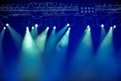Blue stage spotlights Stock Images