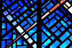 Blue stained glass window. A stained glass window in a historical church, victoria, british columbia, canada Stock Photos