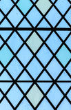 Blue stained glass window diamond pattern Royalty Free Stock Images
