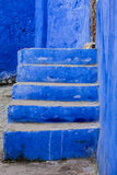 Blue staircase. Leading to the entrance of the house Stock Images