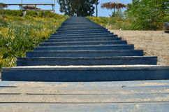 Blue stairs. Beach blue wooden stairs with beach sand on it Stock Photos