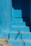 Blue stairs and door. Traditional blue stairs and door with shadow, Chefchaouen, Morocco Royalty Free Stock Photography