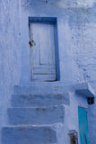 Blue stairs and door. Traditional blue stairs and door with shadow, Chefchaouen, Morocco Royalty Free Stock Photos