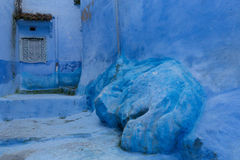 Blue stairs and door. Traditional blue stairs and door with shadow, Chefchaouen, Morocco Royalty Free Stock Photo