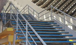 Stairs inside the exibition hall. Blue Stairs inside the exhibition hall with roof in the background Stock Photography