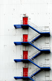 Blue stairs red doors Royalty Free Stock Image
