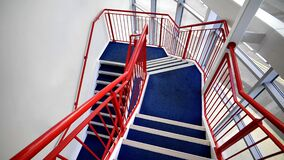 Blue Stairs and Red Handled on White Paint Wall Stock Image
