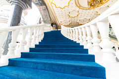 Blue stairs up to mosque Stock Images