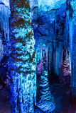 Blue stalactite. Stalactite with blue and purple lights royalty free stock photo