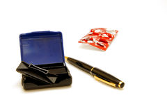 Blue stamp and pen. Blue stamp and a pen and headache tablets Stock Images