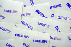 Blue stamped confidential on white memo papers Stock Photo