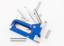 Blue staple gun with staples isolated over white. Background Stock Photo