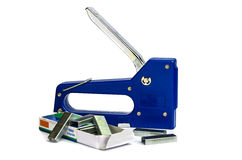 Blue stapler and a box of staple Royalty Free Stock Images